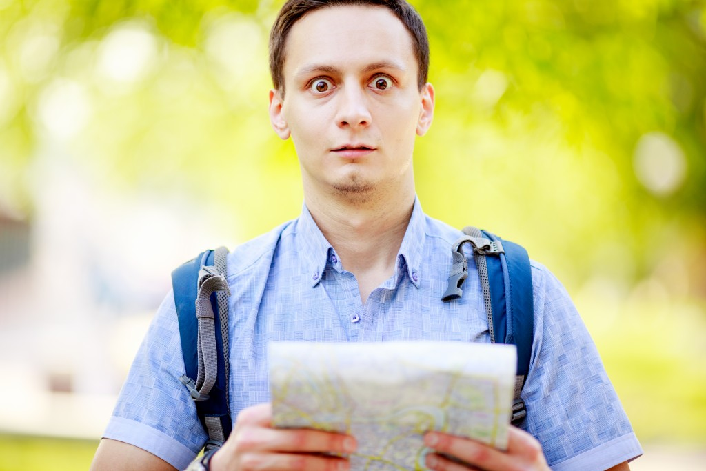 bigstock-Lost-tourist-holding-map-in-ha-92618333-1024x683