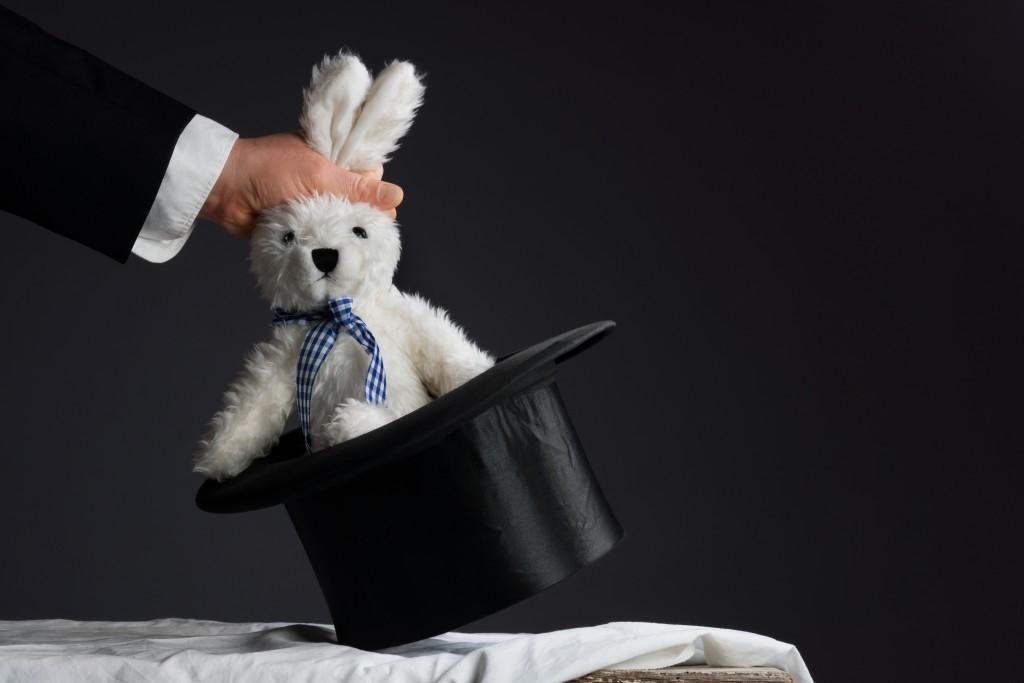bigstock-Man-In-Suit-Pulling-A-Rabbit-O-92080685-1024x683