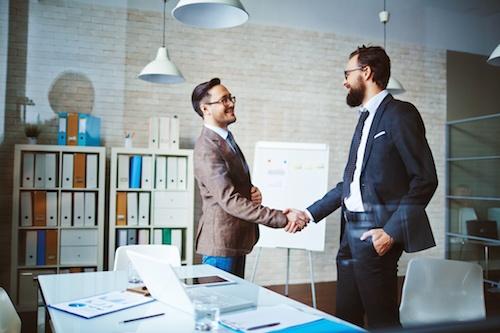 bigstock-Successful-businessmen-handsha-81212432