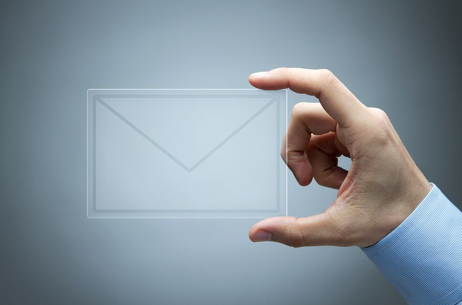 Transparent email icon in human hand