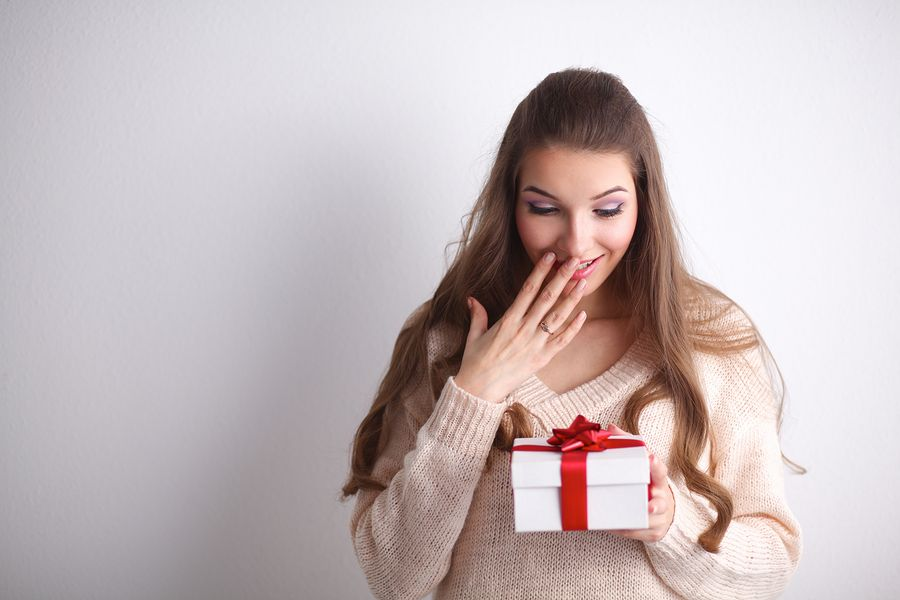 Young woman happy smile holding gift box in hands
